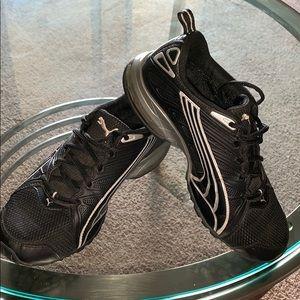 Black Puma athletic shoes